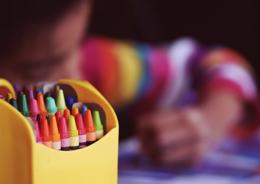 Montessori Nursery learning with crayons