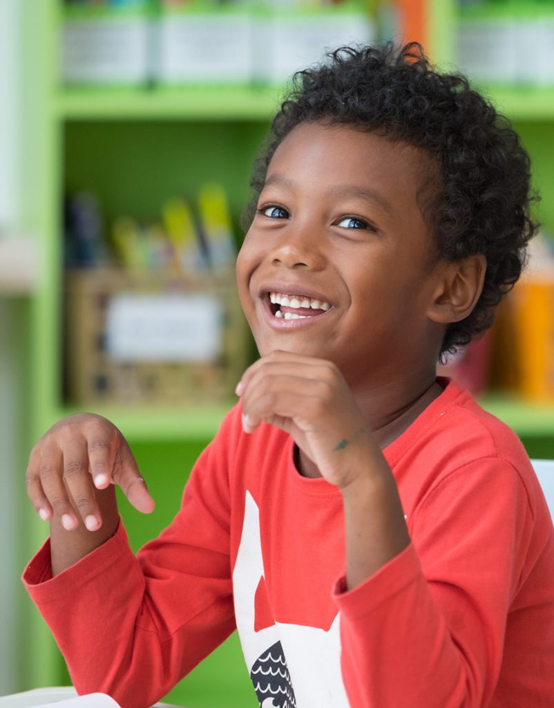 smiling young boy in class