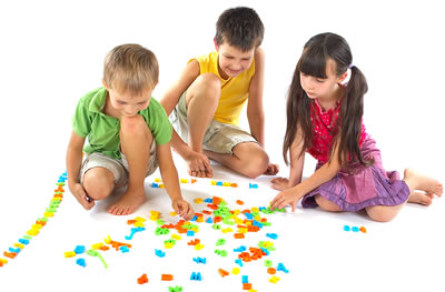 Montessori children playing with letters